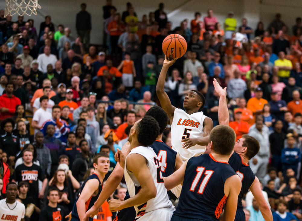 Lanphier's Xavier Bishop (5) floats up for a basket against Mahomet-Seymour in the second half during the Class 3A Champaign Centennial Sectional title game, Friday, March 13, 2015, in Champaign, Ill. Justin L. Fowler/The State Journal-Register