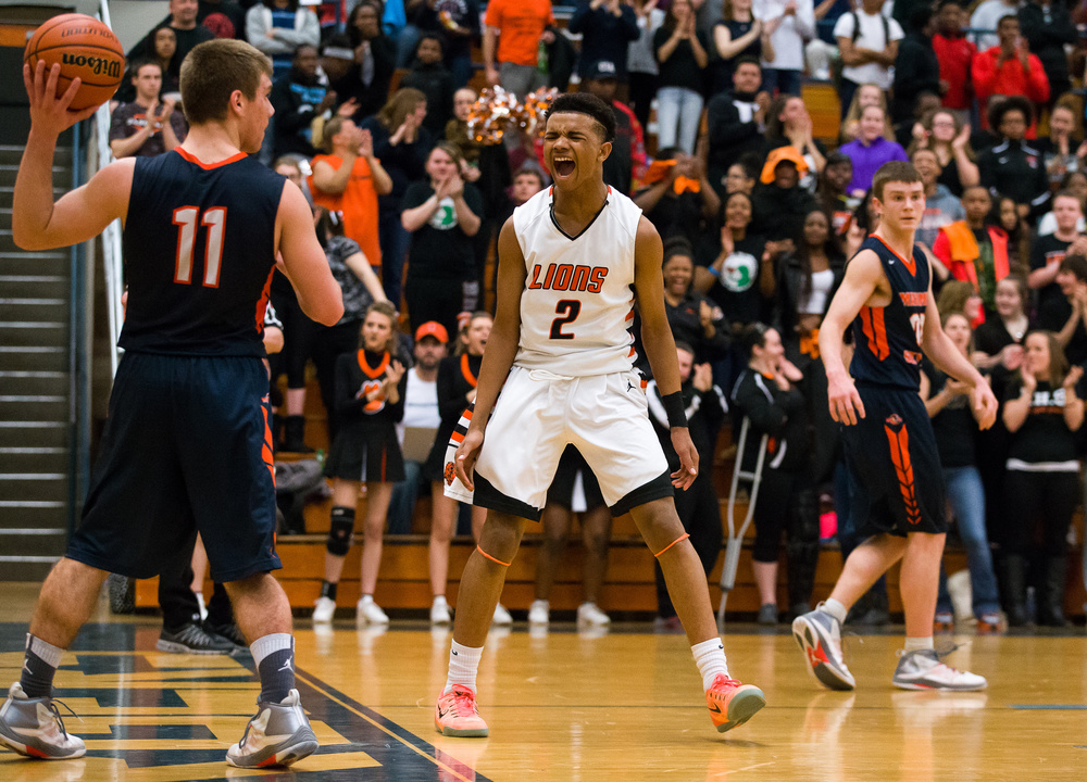 Lanphier's Cardell McGee (2) reacts after making a basket on a fast break against Mahomet-Seymour in the second half during the Class 3A Champaign Centennial Sectional title game, Friday, March 13, 2015, in Champaign, Ill. Justin L. Fowler/The State Journal-Register