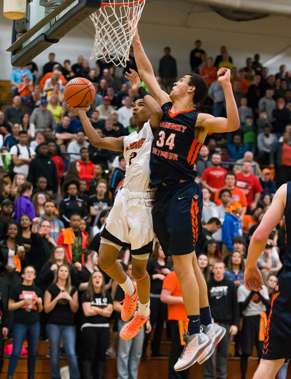 Lanphier's Cardell McGee (2) draws the foul as Mahomet-Seymour's Christian Romine (34) tries to block his shot in the second half during the Class 3A Champaign Centennial Sectional title game, Friday, March 13, 2015, in Champaign, Ill. Justin L. Fowler/The State Journal-Register