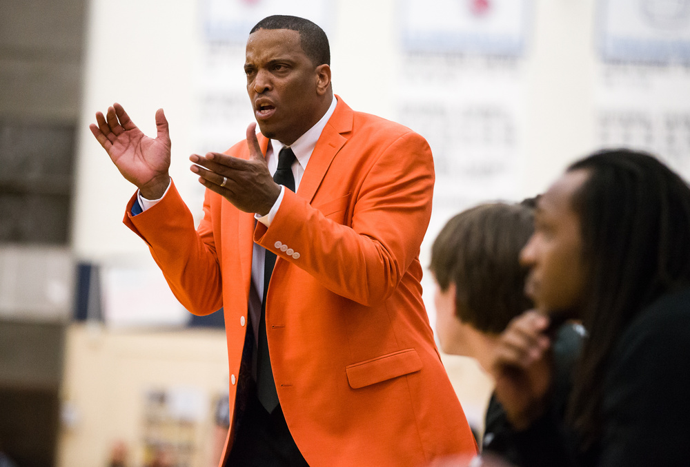 Lanphier head coach Blake Turner cheers on his team as they force a turnover from Mahomet-Seymour in the second half during the Class 3A Champaign Centennial Sectional title game, Friday, March 13, 2015, in Champaign, Ill. Justin L. Fowler/The State Journal-Register