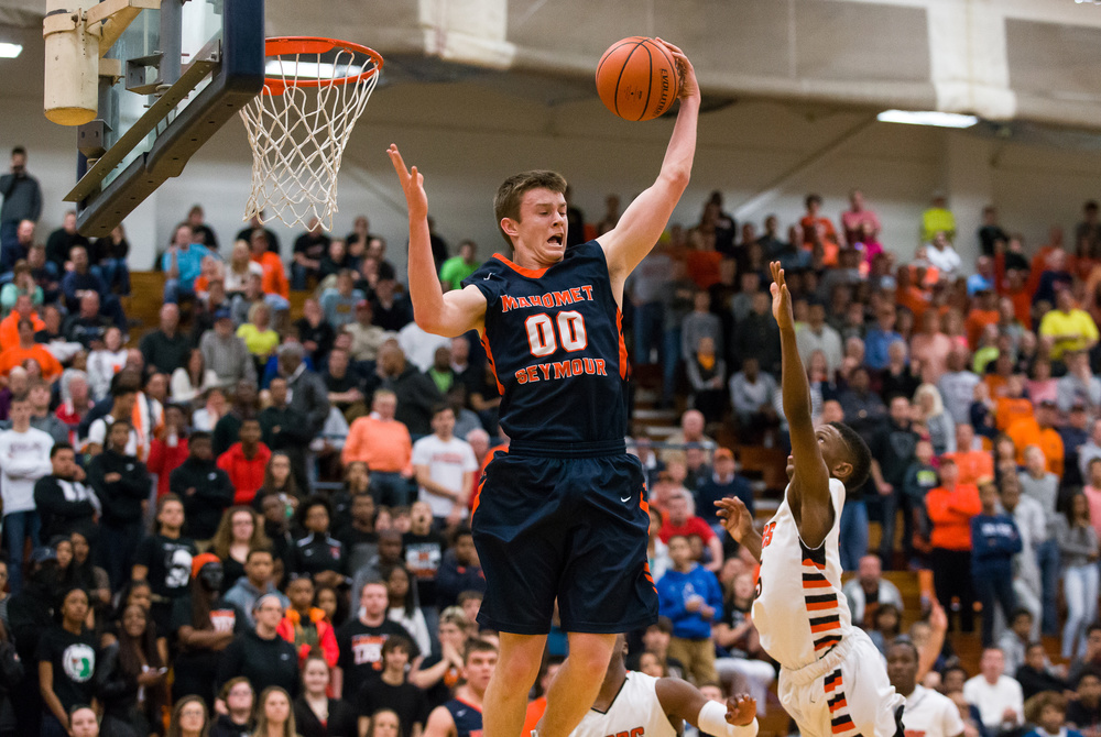 Mahomet-Seymour's Jack Rettig (00) pulls in a rebound against Lanphier's Xavier Bishop (5) in the first half during the Class 3A Champaign Centennial Sectional title game, Friday, March 13, 2015, in Champaign, Ill. Justin L. Fowler/The State Journal-Register