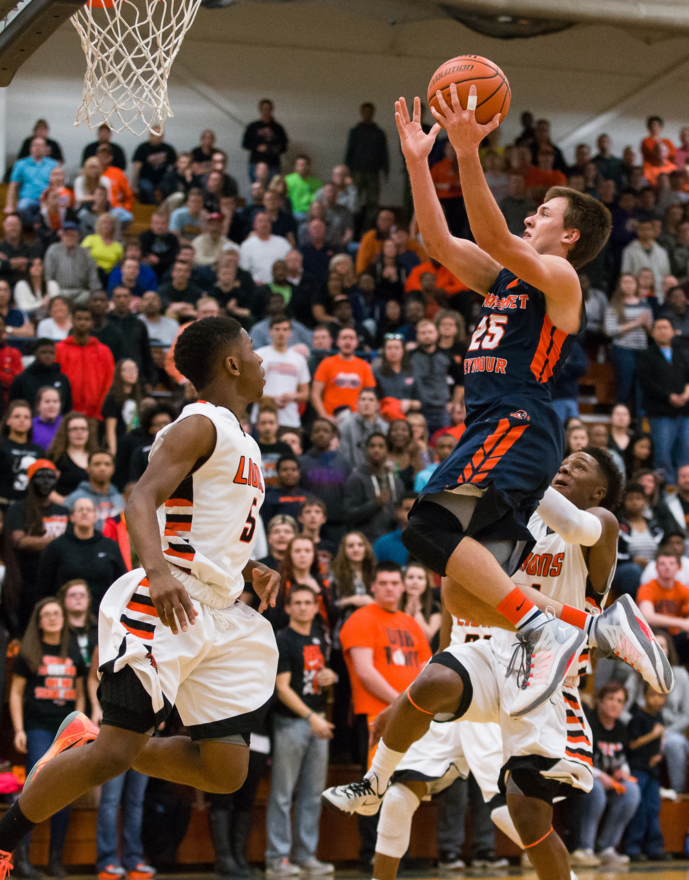 Mahomet-Seymour's Conner Diedrich (25) goes up for a basket in front of Lanphier's Xavier Bishop (5) and Yaakema Rose (1) in the first half during the Class 3A Champaign Centennial Sectional title game, Friday, March 13, 2015, in Champaign, Ill. Justin L. Fowler/The State Journal-Register