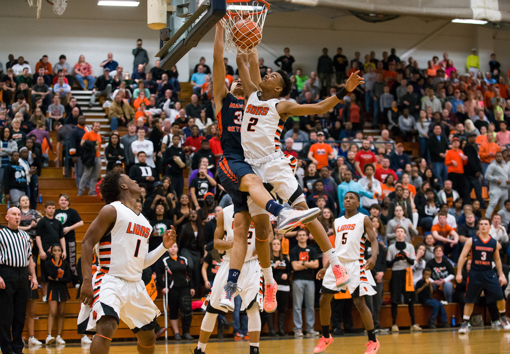 Mahomet-Seymour's Christian Romine (34) dunks the ball against Lanphier's Cardell McGee (2) in the first half during the Class 3A Champaign Centennial Sectional title game, Friday, March 13, 2015, in Champaign, Ill. Justin L. Fowler/The State Journal-Register