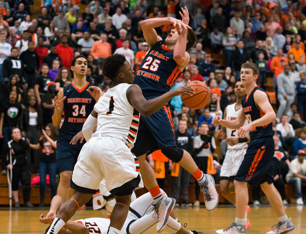 Lanphier's Yaakema Rose (1) swats the ball away from Mahomet-Seymour's Conner Diedrich (25) as he drove to the basket in the first half during the Class 3A Champaign Centennial Sectional title game, Friday, March 13, 2015, in Champaign, Ill. Justin L. Fowler/The State Journal-Register