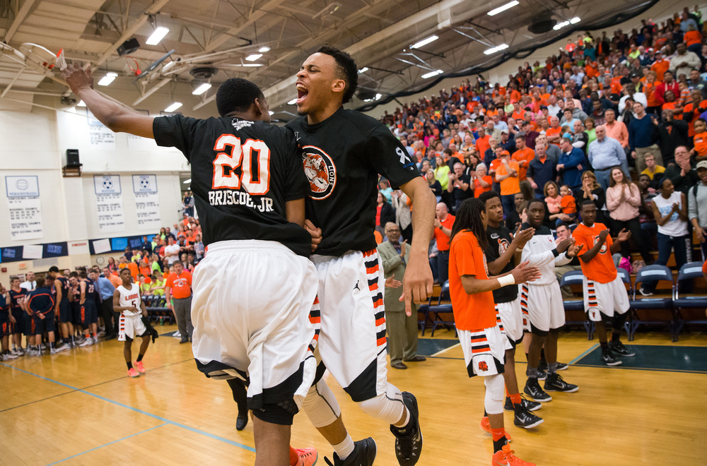 Lanphier's Daryl Jackson (22) leaps up to meet Derick Briscoe (20) during player introductions prior to taking on Mahomet-Seymour in the first half during the Class 3A Champaign Centennial Sectional title game, Friday, March 13, 2015, in Champaign, Ill. Justin L. Fowler/The State Journal-Register