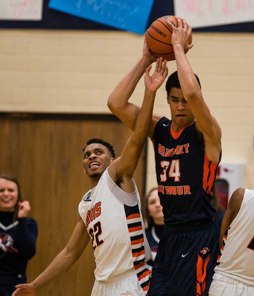 Mahomet-Seymour's Christian Romine (34) grabs a rebound over Lanphier's Daryl Jackson (22) in the first half during the Class 3A Champaign Centennial Sectional title game, Friday, March 13, 2015, in Champaign, Ill. Justin L. Fowler/The State Journal-Register