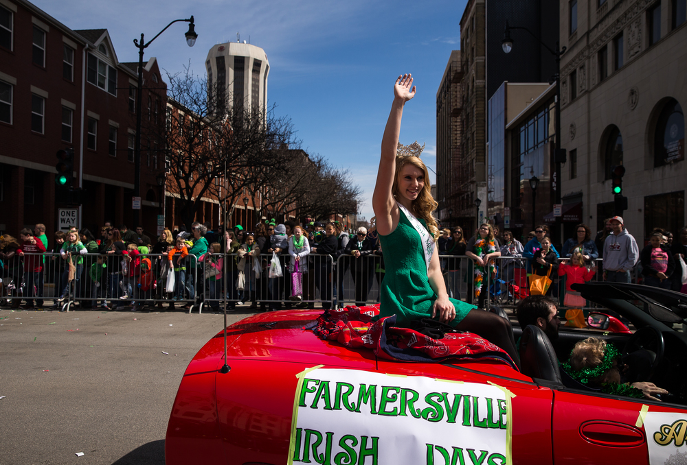 Allie Elmore, 2014 Miss Irish Days, waves to the crowd from the back of a Corvette as the parade makes it's way down Fifth Street during the 2015 Saint Patrick's Day Parade, Saturday, March 14, 2015, in Springfield, Ill. Justin L. Fowler/The State Journal-Register