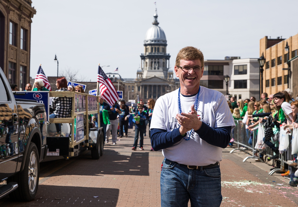 Springfield mayoral candidate Jim Langfelder claps with the band as his float makes its way down Capitol Avenue during the 2015 Saint Patrick's Day Parade, Saturday, March 14, 2015, in Springfield, Ill. Justin L. Fowler/The State Journal-Register