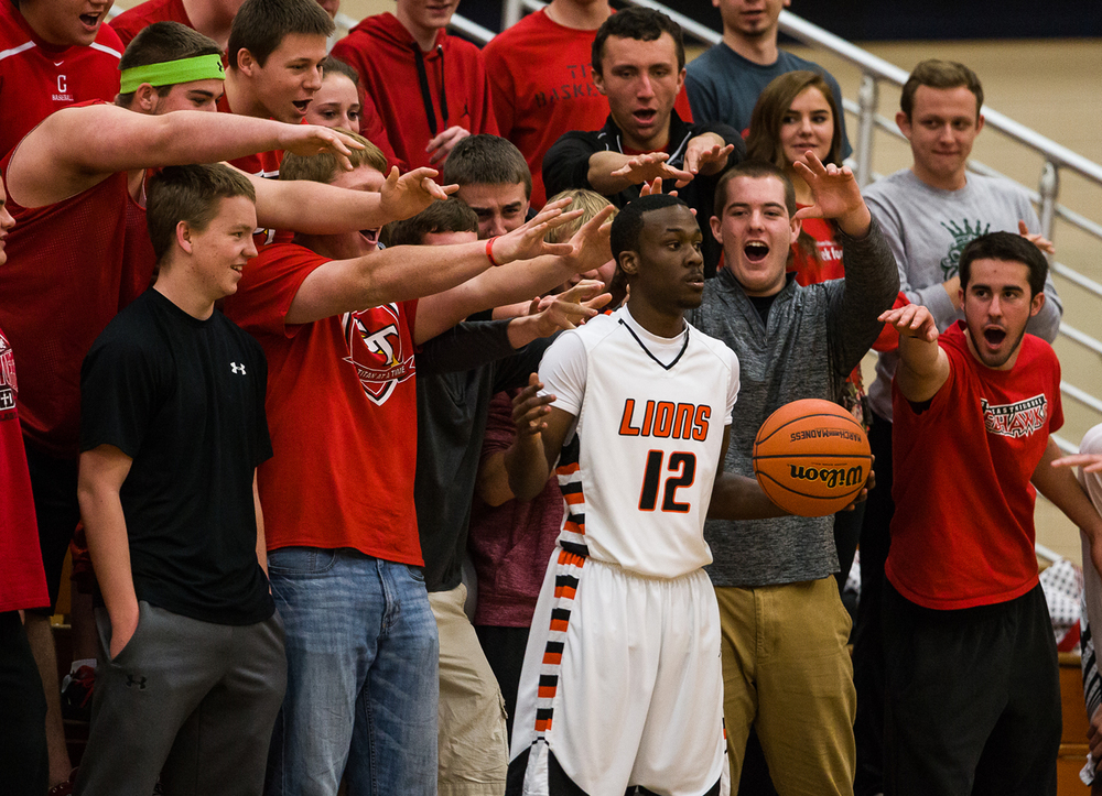 Glenwood fans try to distract Lanphier's Jordan Tribbet (12) as he gets ready to pass the ball in as the Lions take on the Titans in the first half during the Class 3A Champaign Centennial Sectional semifinals, Tuesday, March 10, 2015, in Champaign, Ill. Justin L. Fowler/The State Journal-Register