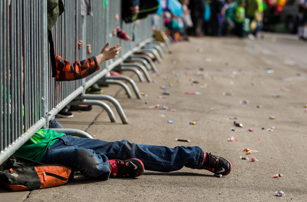 The metal barricades made it a challenge for youth to add to their treasure chest of candy if the throw didn't make it far enough during the 2015 Saint Patrick's Day Parade, Saturday, March 14, 2015, in Springfield, Ill. Justin L. Fowler/The State Journal-Register