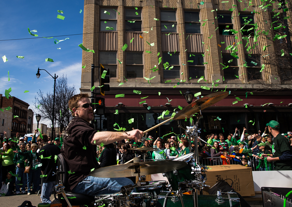 Larry Caulk, the drummer for The Blue Ribbon Revival, plays the drums among a cloud of confetti on the float promoting the SOHO Music Festival during the 2015 Saint Patrick's Day Parade, Saturday, March 14, 2015, in Springfield, Ill. Justin L. Fowler/The State Journal-Register