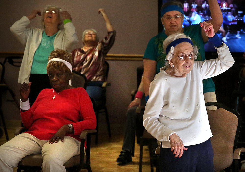 Betty Sias, 85, right, gets in a workout along with other residents of Springfield Supportive Living on Monday, March 16, 2015. David Spencer/The State Journal-Register