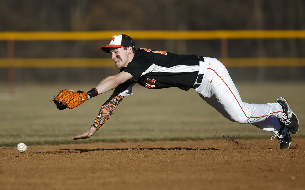 Lanphier short stop Kody Childers dives for an infield grounder against Auburn at Lincoln Land Community College Monday, March 16, 2015. Ted Schurter/The State Journal-Register