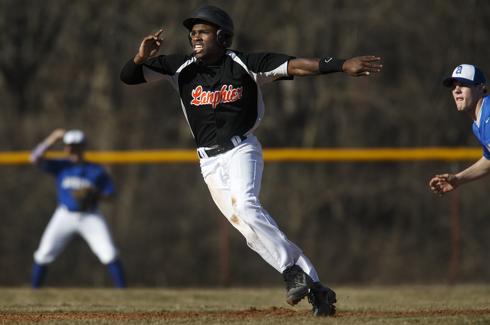 Lanphier's Jared Griffin takes a big lead off second base against Auburn at Lincoln Land Community College Monday, March 16, 2015. Ted Schurter/The State Journal-Register