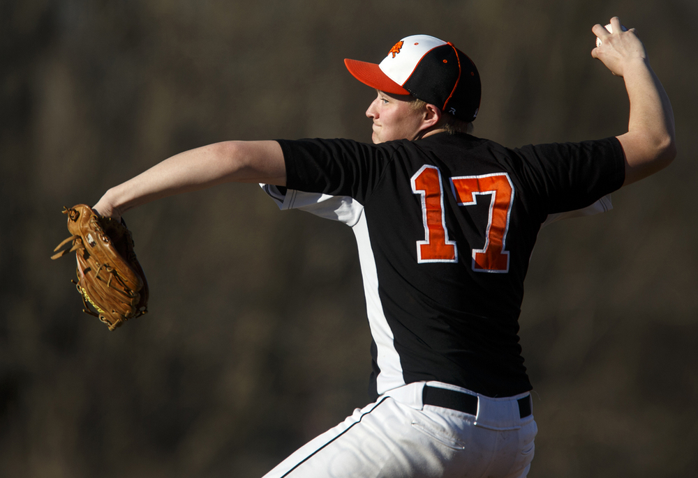 Lanphier's Jerry Nataut pitches against Auburn at Lincoln Land Community College Monday, March 16, 2015. Ted Schurter/The State Journal-Register