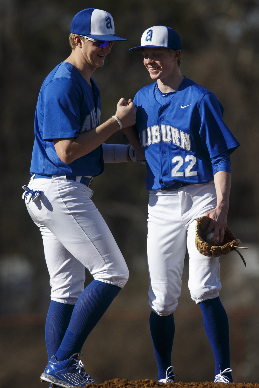 Auburn's Cooper Eaker encourages pitcher Tristan Weaver as he prepares to open the season against Lanphier at Lincoln Land Community College Monday, March 16, 2015. Ted Schurter/The State Journal-Register