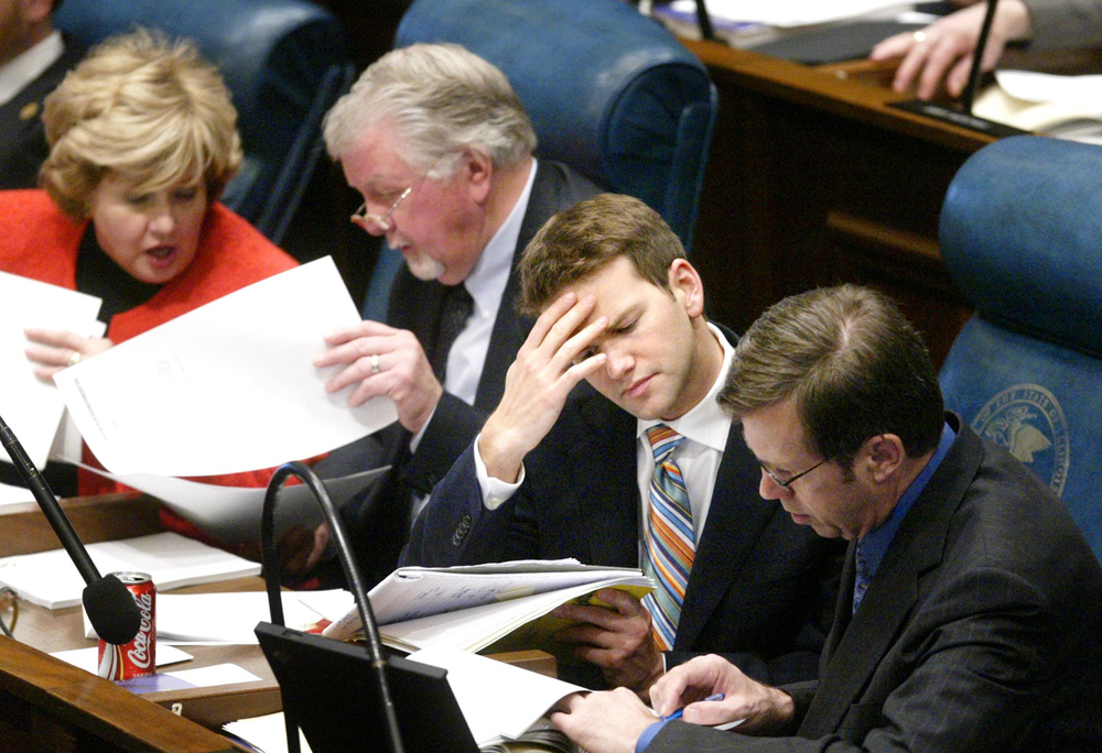 From left, Rep. Renee Kosel, R-New Lenox; Sen.Gary Dahl, R-Granville; Aaron Schock and Rep.Dave Winters, R-Shirland, review copies of Gov. Rod Blagojevich's budget address before the governor's speech Feb. 16, 2005.  File/The State Journal-Register