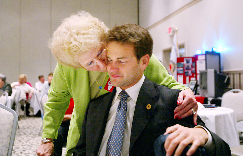 State Rep. Aaron Schock gets a kiss from friend Jo Cramer during a state Crime Stoppers convention in East Peoria. Cramer is the executive director of the Rural Peoria County Council on Aging and Schock was successful in obtaining a $5,000 grant for the organization. File/The State Journal-Register