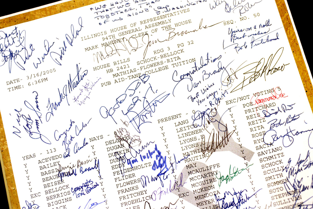 The first bill of which State Rep. Aaron Schock, R-Peoria, was chief sponsor — signed by fellow legislators — hangs on his Springfield office wall.  File/The State Journal-Register
