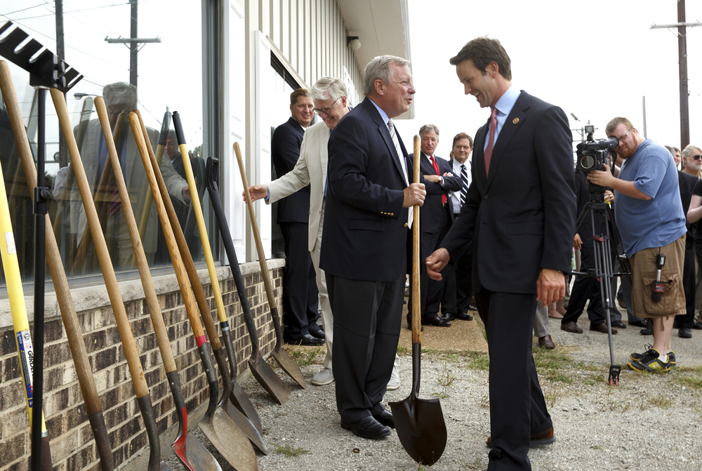 U.S. Sen. Dick Durbin, center, U.S. Rep. Aaron Schock, R-Peoria, and Sangamon County Board Chairman Andy Van Meter pick up shovels for the groundbreaking for the Carpenter Street railroad underpass Thursday, Aug. 21, 2014. Construction of the underpass at 10th Street is the first piece of the rail consolidation plan to get underway. File/The State Journal-Register