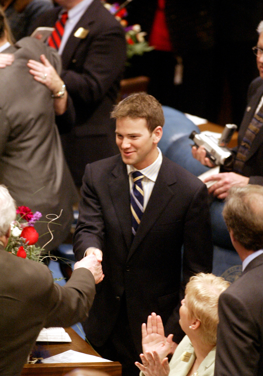 State Rep. Aaron Schock, R-Peoria, is congratulated after being sworn in to the 94th General Assembly at the Illinois State Capital Wednesday, Jan. 12, 2005. File/The State Journal-Register