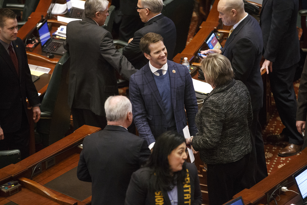 U.S. Rep. Aaron Schock visited with legislators on the floor of the Illinois House before Gov. Bruce Rauner delivered his budget address Wednesday, Feb. 18, 2015. File/The State Journal-Register