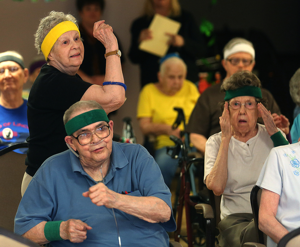 At left, residents Marilyn LaChance and Matt Dolinar move to the music while exercising during the class on Monday, March 16, 2015.David Spencer/The State Journal-Register