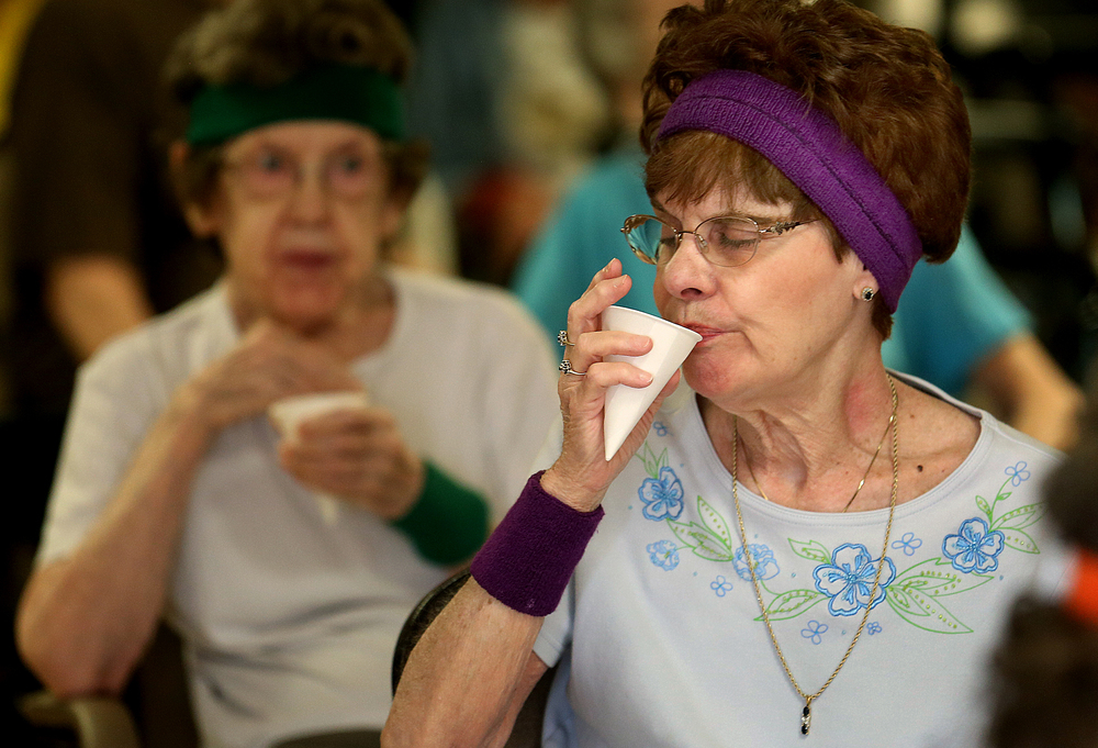 Water breaks are mandatory during the class. Resident Marilyn Klindt cools down before starting again on Monday, March 16, 2015. David Spencer/The State Journal-Register