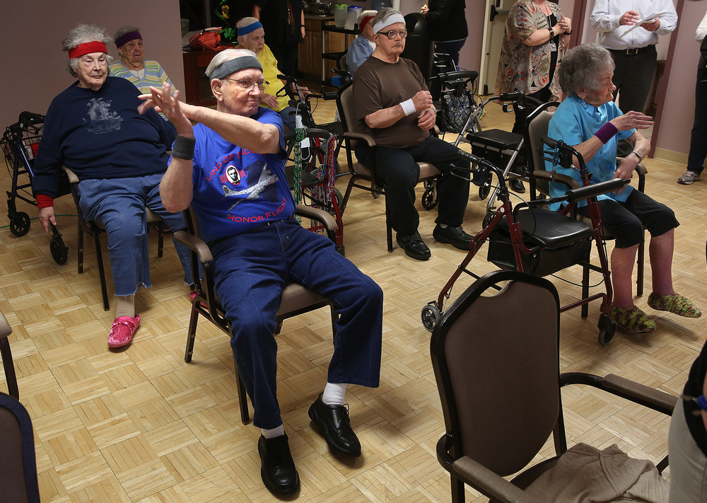 A certain percentage of the residents participate in the class while seated. Resident Ed Garlin at front left was having a good time during the class on Monday, March 16, 2015. David Spencer/The State Journal-Register