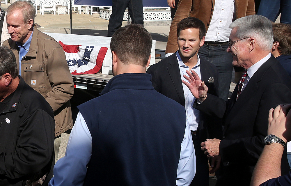 U.S. Rep. Aaron Schock spoke at a rally for Republican gubernatorial candidate Bruce Rauner, left in Springfield  Nov. 3, 2014. Also attending was former Illinois Gov. Jim Edgar, right. File/The State Journal-Register