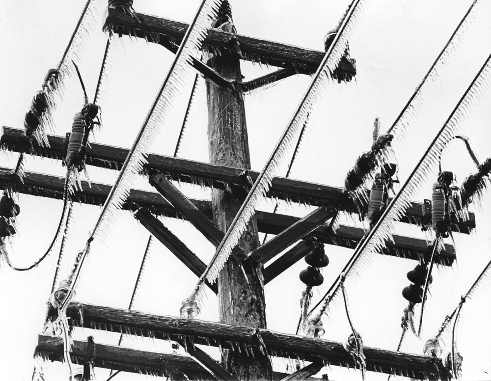 Ice coats a utility pole and wires, March 1978.
