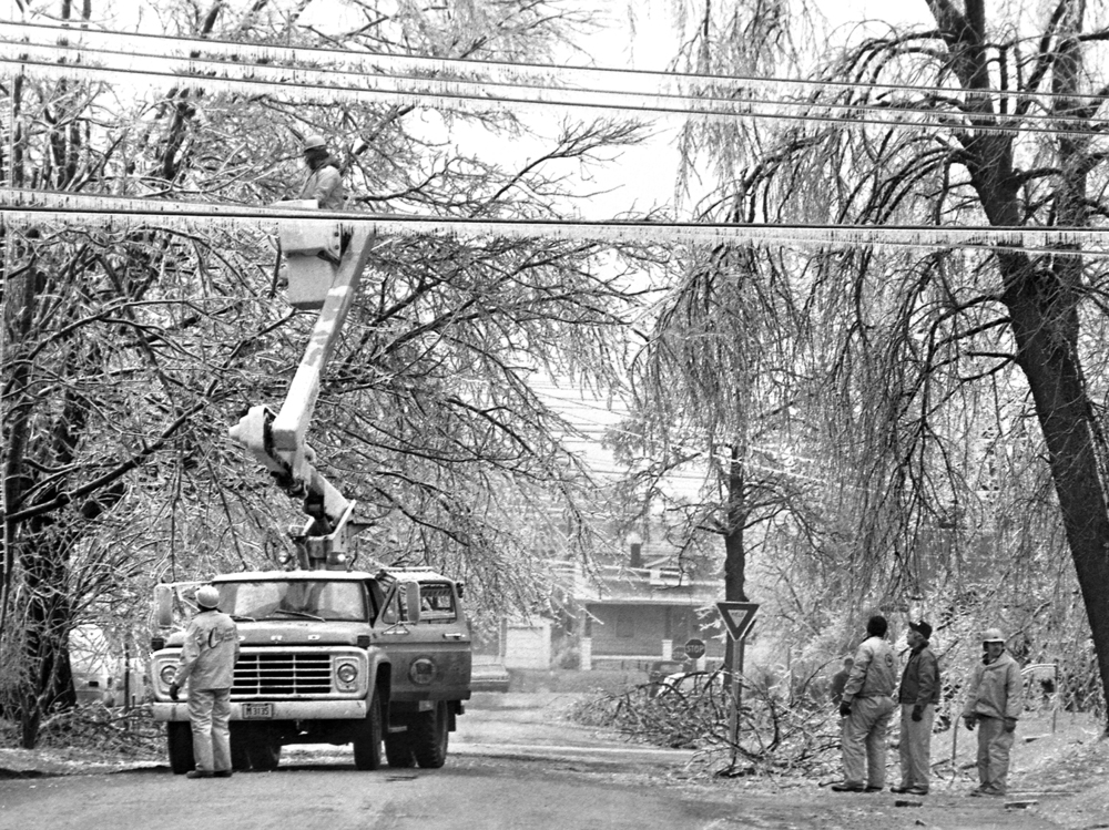 A City Water, Light and Power crew work on power lines on E. Oberlin Avenue at Yale Boulevard, March 1978.