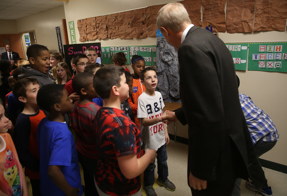 Fourth grade students including Chase Heyen, who got to shake Gov. Rauner's hand, met with the state leader in a hallway of the school before Gov. Rauner toured the wax works. David Spencer/The State Journal-Register