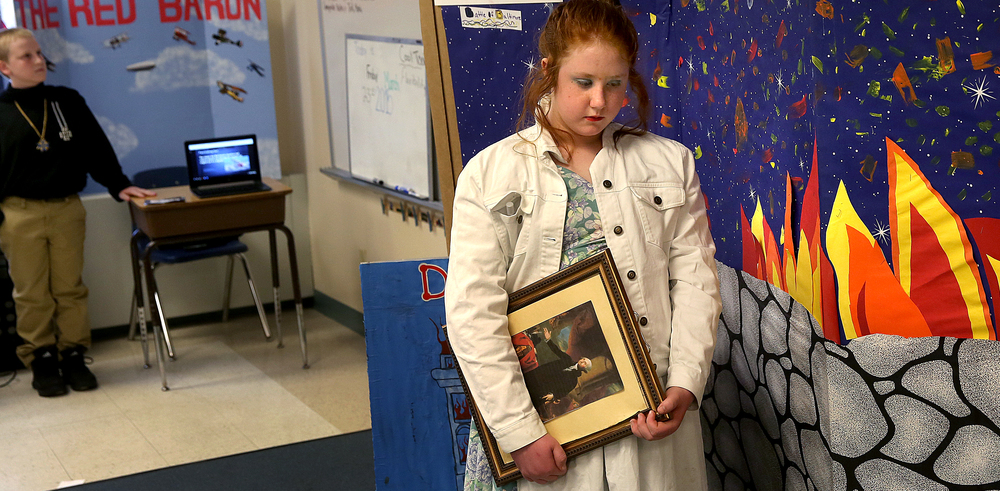 Dolly Madison, holding a framed portrait of George Washington, is presented by student Hannah Bramblett while The Red Baron at far left is presented by student Derek Kennedy. David Spencer/The State Journal-Register