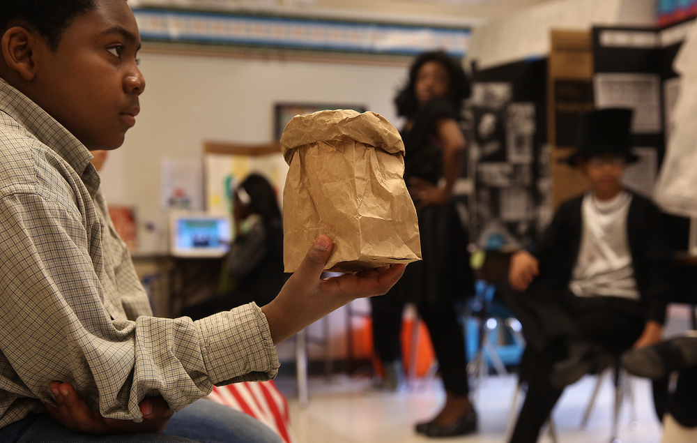 The sole prop held by George Washington Carver (presented by student Aarvon Suttle) was a paper bag of peanuts. David Spencer/The State Journal-Register