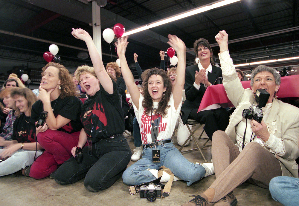Employees at the EMI Manufacturing plant in Jacksonville cheer when Garth Brooks steps on a stage and thanks them for their work making all 50 million of his recordings during a tour of the plant in Jacksonville March 1995. File/The State Journal-Register