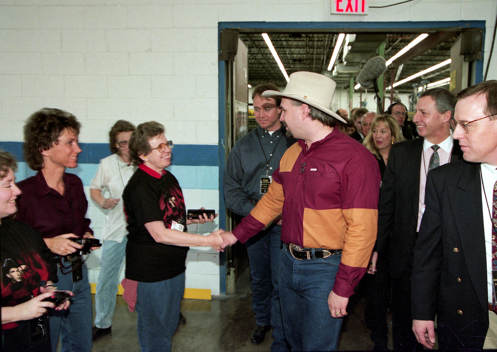 Country music artist Garth Brooks greets employees during a tour of the EMI Manufacturing plant in Jacksonville March 1995. File/The State Journal-Register