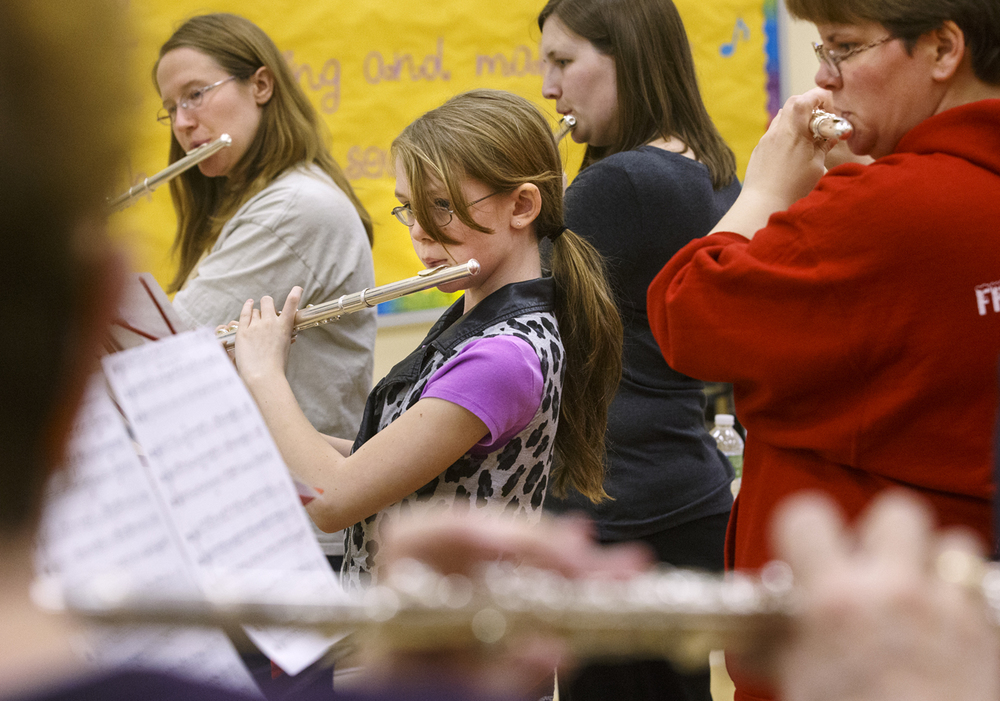 Jordan Watts rehearses with the Debby Eddy Flute Choir during a practice at First United Methodist Church Monday, March 9, 2015. The choir celebrated its 30th anniversary with a concert featuring past and current members of the choir March 29, 2015. Ted Schurter/The State Journal-Register