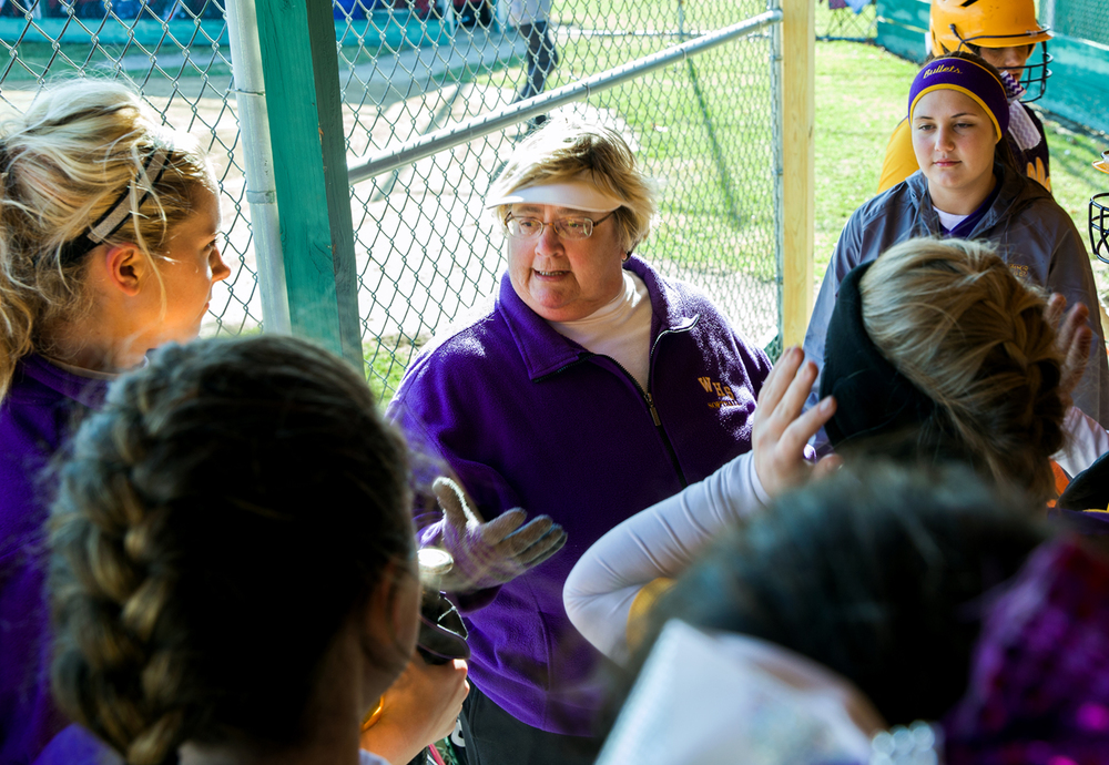 Williamsville softball head coach Jane Grebner sets out a game plane with her team in the dugout prior to the Bullets taking on Lincoln, Friday, March 27, 2015, in Lincoln, Ill. After 31 years, Grebner is retiring and coaching her last season with the Bullets. Justin L. Fowler/The State Journal-Register