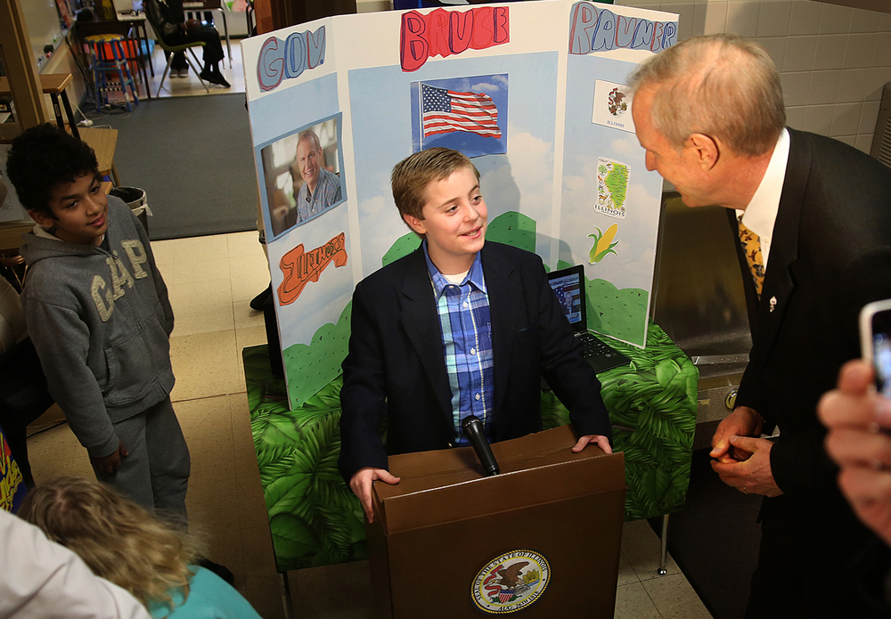 Gov. Rauner seemed to get a kick out of having a face to face talk with himself at Vachel Lindsay School's wax museum Tuesday, March 24, 2015.  Fifth grader Harlan Gargano stood behind a makeshift podium outfitted with microphone and the official seal of the state of Illinois and spoke with the governor. Lindsay fifth graders portrayed notable historical figures from U.S. and the world. David Spencer/The State Journal-Register