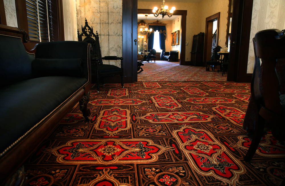 Featuring a number of different period patterns, wool carpets woven in England by the English Wilton Company are featured in each of the renovated rooms, including the library which dates to 1857. David Spencer/The State Journal-Register