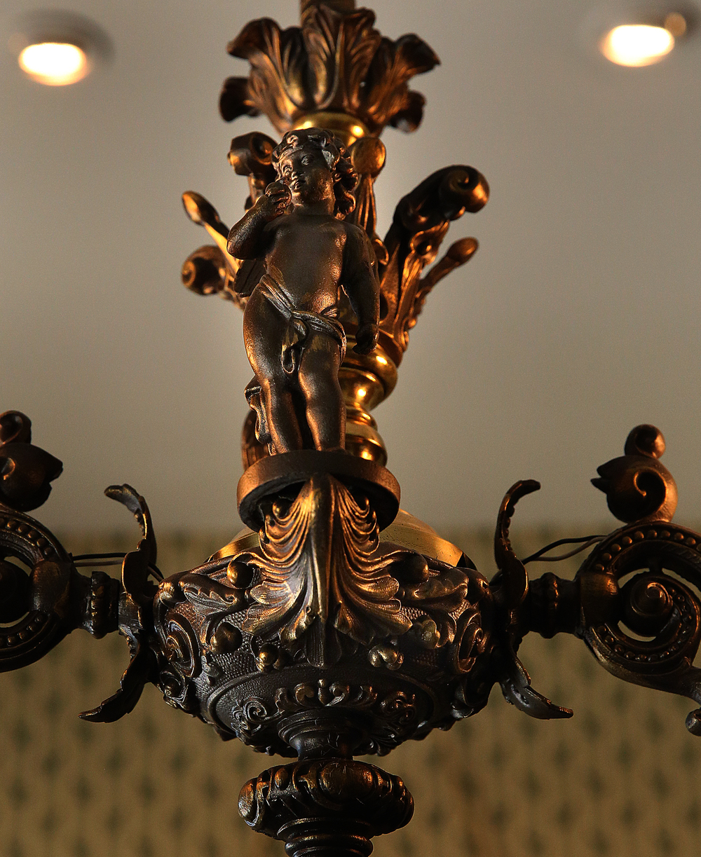 More than one cherub graces this 1850s era brass chandelier that hangs from the ceiling of the sitting room in the home.  David Spencer/The State Journal-Register