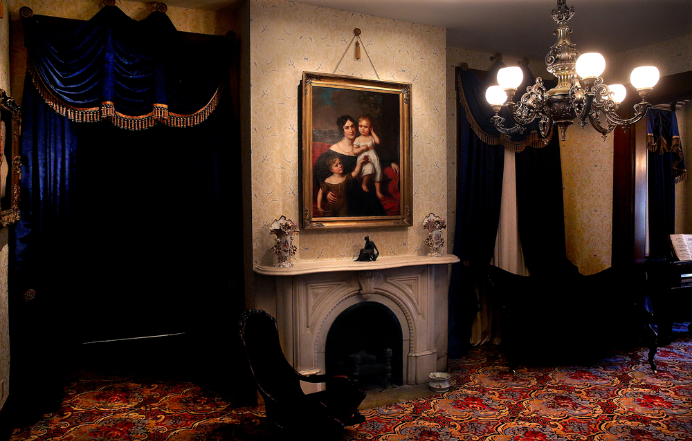 Lit by a recessed ceiling spotlight, an 1838 oil painting of Ann Laura Reed is one of the focal points in one of the two 1833 formal parlors in the home. A cousin of Benjamin Edwards, Reed is shown along with her two children Thomas and Duff. David Spencer/The State Journal-Register