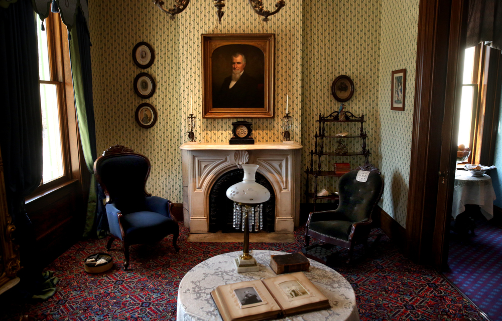 In the Sitting Room, new oak-leaf patterned wallpaper covers the walls along with new carpeting, recessed lighting and other improvements. An oil painting of Benjamin Edwards can be seen over the fireplace. David Spencer/The State Journal-Register
