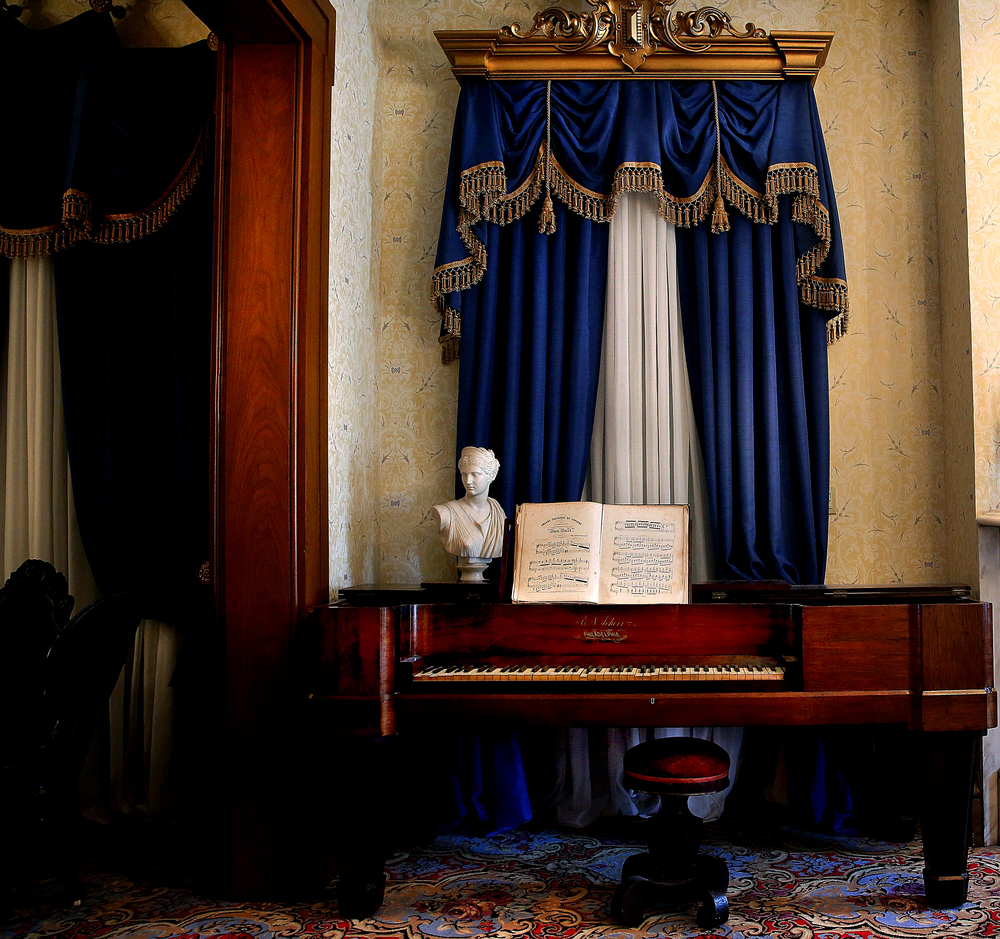 A Roman bust of Diana, goddess of the hunt, is displayed atop an 1850s era square grand piano made by E. N. Scherr of Philadelphia on display in one of the home's formal parlors. David Spencer/The State Journal-Register