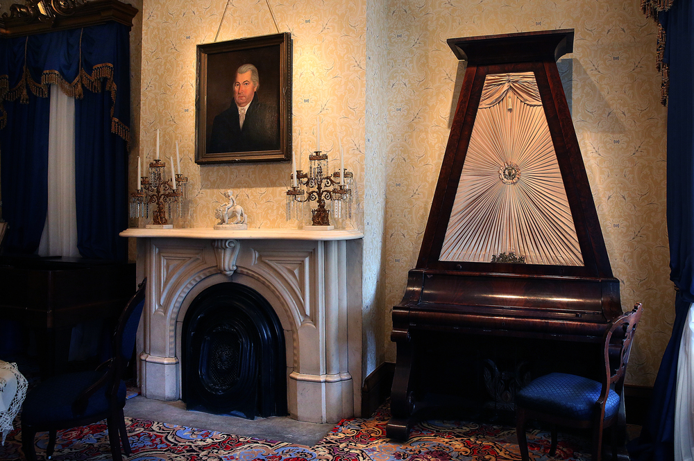 The front formal parlor at right features a rare upright grand piano from 1835 once owned by the Enos family on long-term loan to the Art Association from the IL State Museum. An oil painting over the fireplace at left is of Ninian Edwards. David Spencer/The State Journal-Register