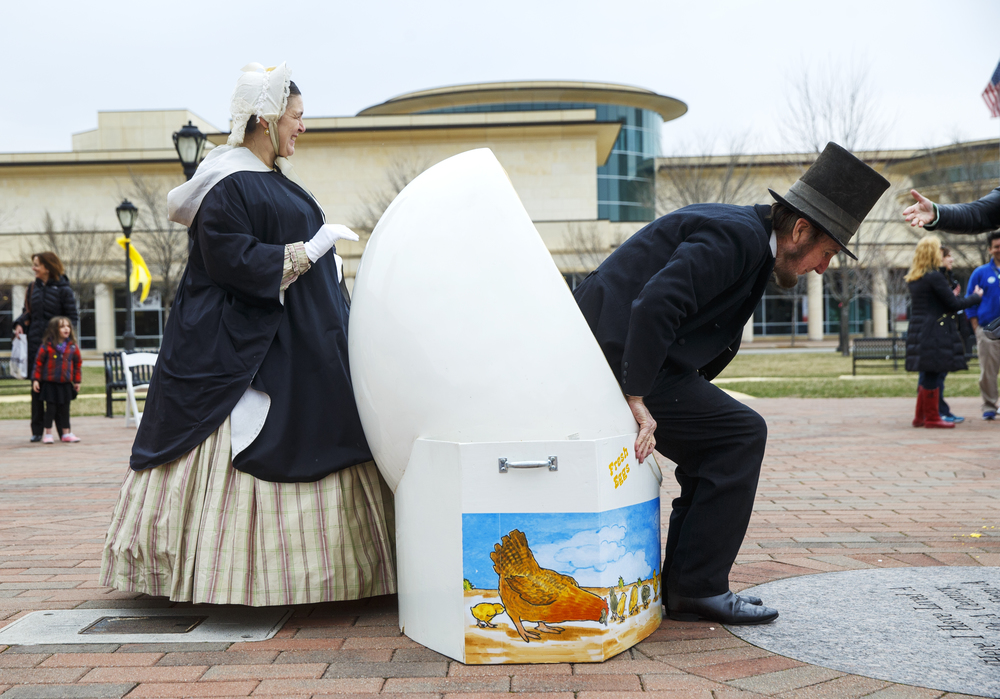 Abraham Lincoln eases out of an egg after posing for a photo during the Egg Roll in the Park Sunday, March 29. The event featured face-painting and tattoo stations, 19th century games, crafts, and free food. Ted Schurter/The State Journal-Register