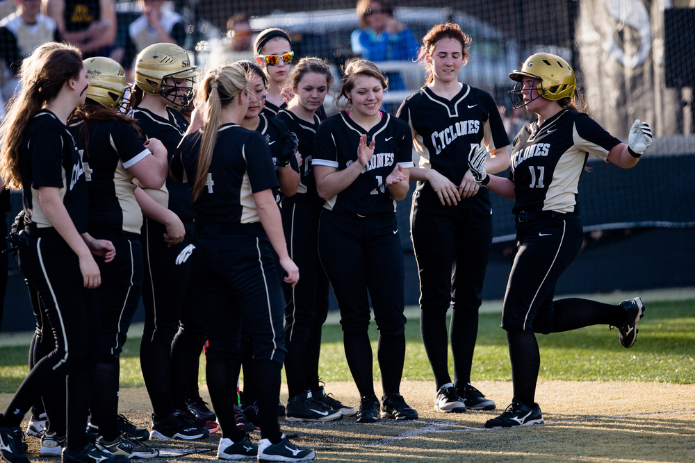 Scared Heart-Griffin's Whitney David (11) is greeted at home plate by her team after hitting a home run against Rochester in the fourth inning at Comstock Field, Wednesday, April 1, 2015, in Springfield, Ill. Justin L. Fowler/The State Journal-Register