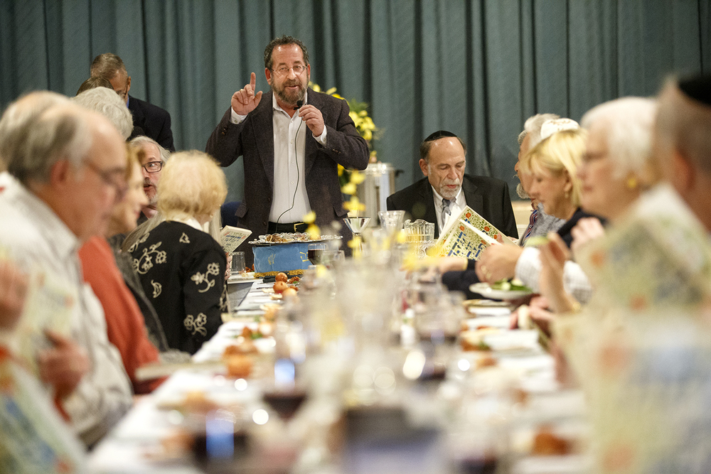 Rabbi Michael Datz welcomes guests to the Community Passover Seder at Temple B'rith Sholom Saturday, April 4, 2015. Ted Schurter/The State Journal-Register