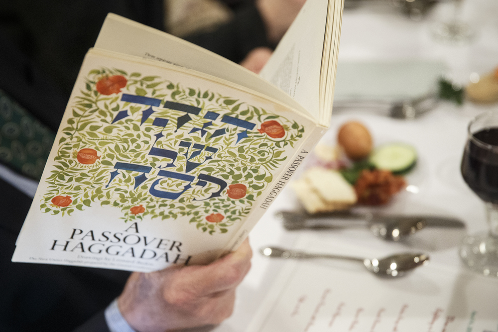 "A guest follows along with ""A Passover Haggadah"" during the Community Passover Seder at Temple B'rith Sholom Saturday, April 4, 2015.  Ted Schurter/The State Journal-Register"